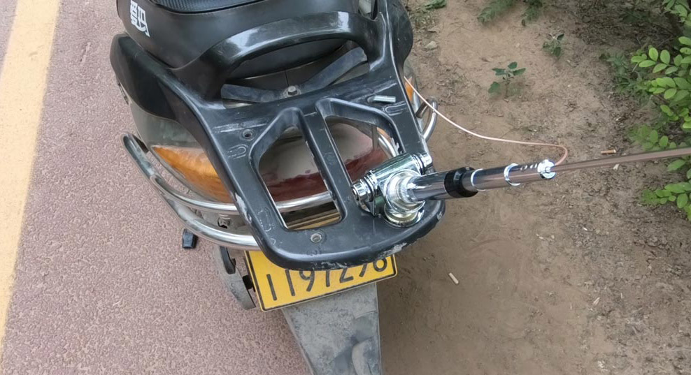 The antenna is mounted to the rear frame of the motorcycle